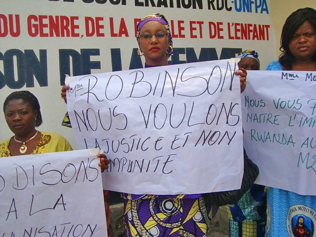 "On Saturday, the International Day of Peace, AJWS grantees and other women's groups in North Kivu gathered to protest ongoing conflict and finalize a joint statement to Mary Robinson. This activist's sign reads, ""Mrs. Robinson, we want justice and not impunity."""