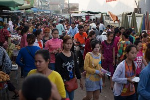 Young women fill the streets near a Cambodian garment factory.