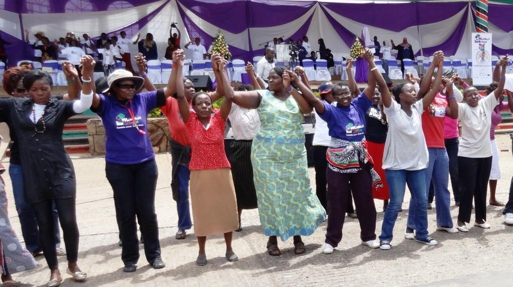 Women holding hands at Women's Empowerment Link