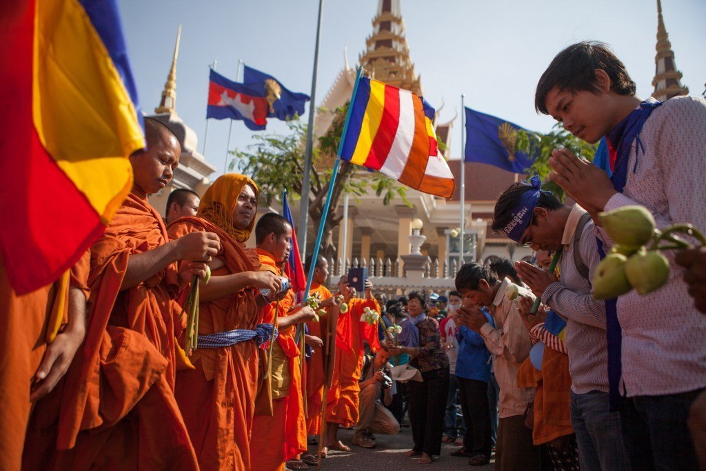 Monks bless the crowd at a human rights demonstration in Phnom Penh.
