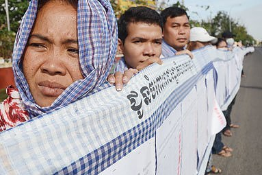 Cambodian villagers hold aloft a 230-metre krama during their protest in front of the National Assembly. Photo credit: Pha Lina