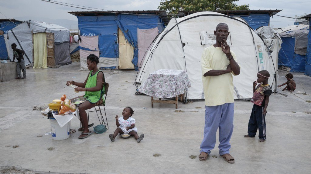 Haitians in a tent camp