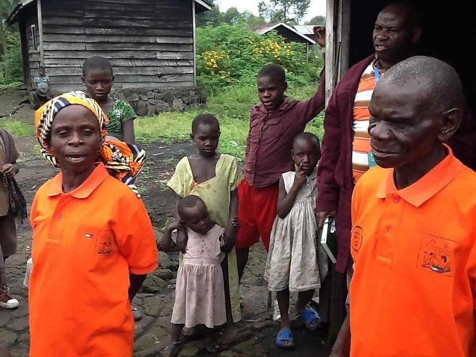 Masinda, her husband and members of their community.