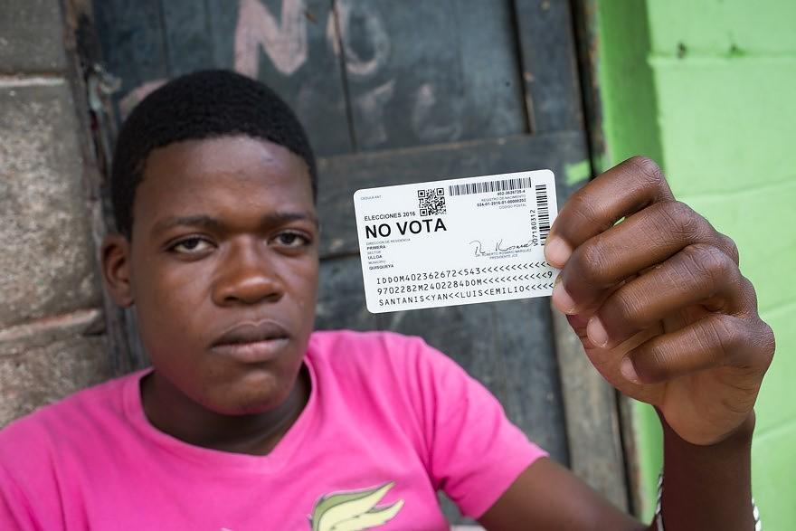 Luis Emilio Santanis Yan, with his ID from the Batey Ulloa, in San Pedro de Macorís, Dominican Republic. He is of Haitian descent and is unable to vote in the Dominican Republic's upcoming elections. Photo courtesy of Fran Afonso.