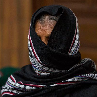 A sexual slavery survivor stands during a break in the Sepur Zarco trial in Guatemala.