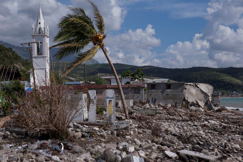 Hurricane Matthew inflicted heavy damage on coastal communities across Haiti. Radyo VKM, which reaches residents of the hard-hit Southern Department pictured here, is helping people rebound. Here, near the sea, buildings lie in rubble and a palm tree, battered by the wind, is severely bent. Photo by Jonathan Torgovnik