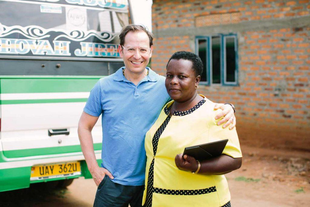 Here I am standing with Beatrice Rukanyanga, Coordinator of Kwataniza Women Farmers Group, whom I visited earlier this year to learn more about KWG's efforts to support women's land rights in rural Uganda. Photo by Christine Han