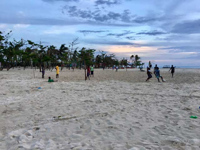 Young men playing soccer on the beaches of Port Salut, Haiti. Life is slowly resuming on these shores. Photo by Sumit Galhotra