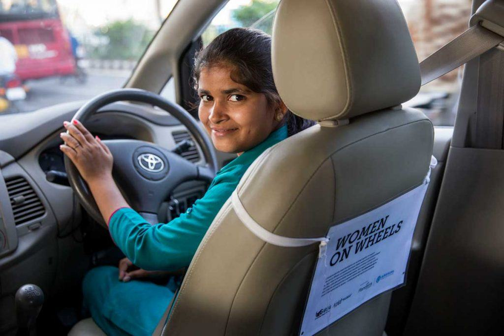 Khushi Prajapati learned how to drive a cab from Azad Foundation, an AJWS grantee that supports low-income women living in Delhi slums to pursue non-traditional careers. Note: Khushi was not a participant in the research study described in this post. Photo by Jonathan Torgovnik