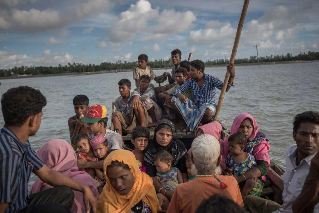 Rohingya men, women and children fleeing for safety on a crowded boat. AP Images