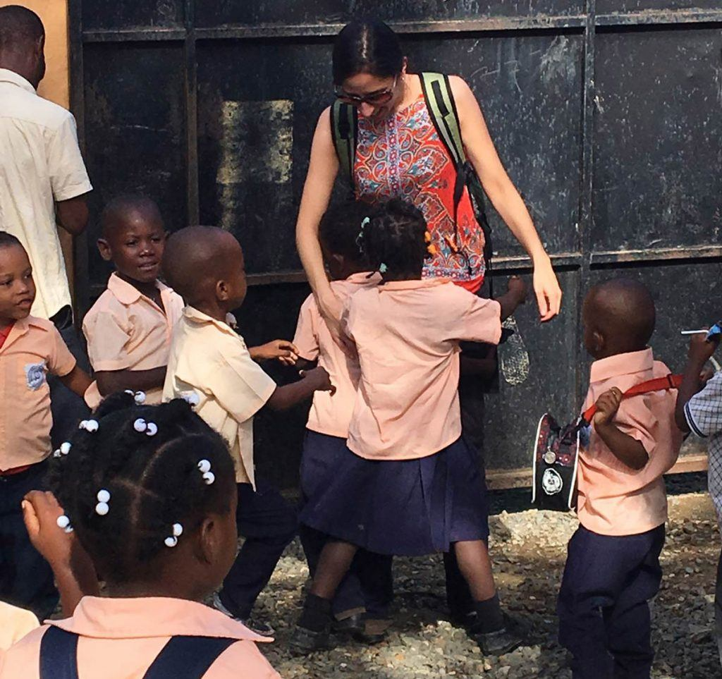 Children greet the AJWS team at Escuela Anaisa, a school run by AJWS grantee MUDHA in Batey Palmerejo, Dominican Republic.